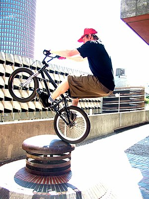BMX bicycle rider is doing the Foofa-Noo. Used...