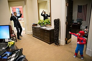 Spider-Man - U.S. President Barack Obama pretending to be webbed up by a boy dressed in a Spider-Man costume inside the White House