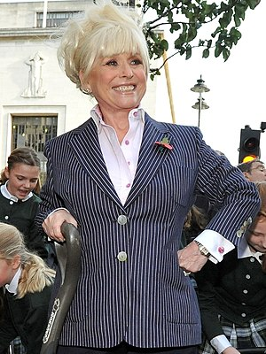 Sharon Watts - Grant and Phil's mother, Peggy Mitchell as played by Barbara Windsor (pictured), was featured prominently in Sharon's return storyline in May 2001, when she unwittingly sold The Queen Vic public house to her.