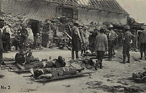 men on stretchers with medical staff standing