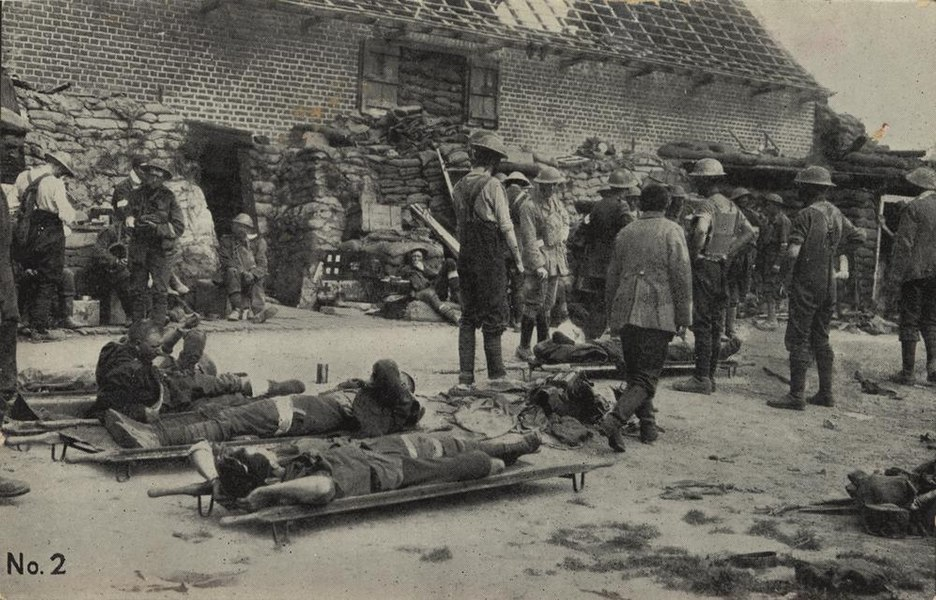Creator:  Unidentified.Location: Flanders, Belgium.Date: 7 June 1917Description:  The image shows approx. 2 dozen wounded men, 5 visible in stretchers, against the back drop of a brick building and sandbags. Number 2 in the 'Our Boys at the Front' series of postcards. From official photographs by special permission of the Department of Defence. Proceeds to the Australian Comforts Fund. (Printing on verso of postcard) A series of official war photographs of Australian service personnel in France and Belgium, which the Australian Comforts Fund turned into postcard to sell for fund raising purposes.Learn more about this image at the State Library of Queensland: http://hdl.handle.net/10462/deriv/2080 Information about State Library of Queensland's collection: http://www.slq.qld.gov.au/resources/picture-queensland