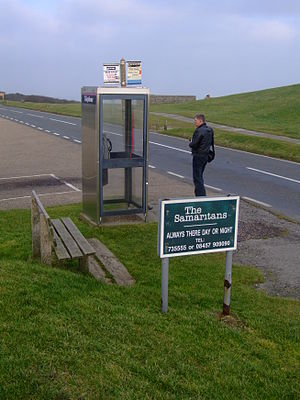 Beachy Head - Phone booth and sign advertising the Samaritans at Beachy Head