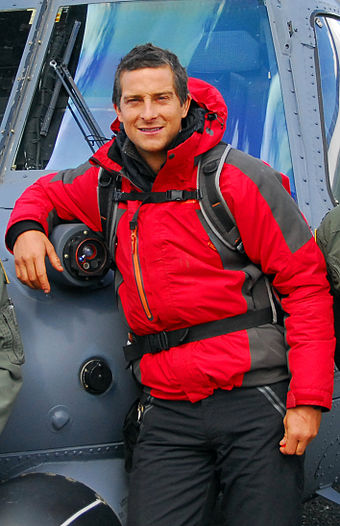 Bear Grylls in front of an Alaska Air National Guard, 210th Rescue Squadron HH-60 Pave Hawk helicopter before heading out to Spencer Glacier to film Man vs. Wild (Born Survivor) Bear Grylls 2.jpg