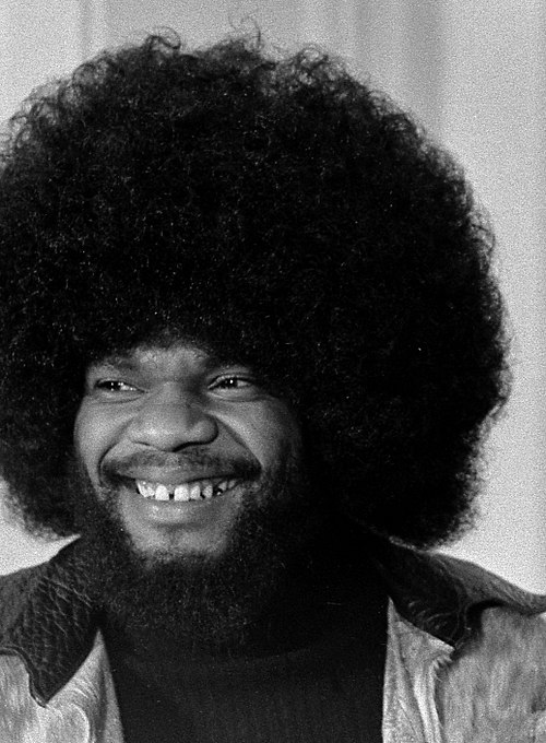 Black and white photo of grinning Billy Preston