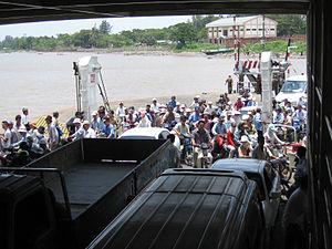 Boarding ferry on Mekong.jpg
