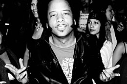 Boots Riley in a leather jacket.jpeg