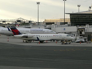 Comair - Comair CRJ100ER with new livery at Boston Logan International Airport