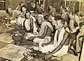 Brahmins worship in the Kalighat temple, Calcutta in 1945.jpg