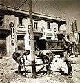 British and Italian soldiers work to restore communication facilities, Sicily, 1943 (23935035183).jpg