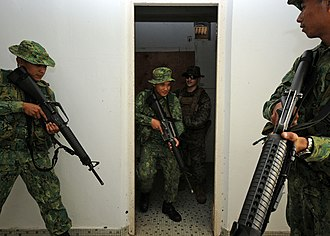 Close quarters combat - Bruneian soldiers and US Marines practice clearing a room during CARAT 2011 exercises in Brunei.