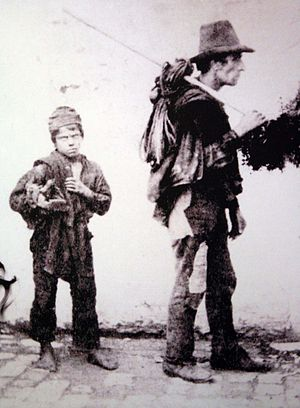 Chimney sweep - A master chimney sweep (right) and his apprentice boy, known as a Spazzacamino, in Italy at the end of the 19th century