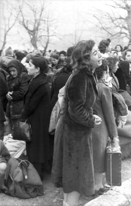 A young woman weeps during the deportation of the Romanoite Jews of Ioannina on 25 March 1944. Almost all of the people deported were murdered on or shortly after 11 April 1944, when the train carrying them reached Auschwitz-Birkenau. Bundesarchiv Bild 101I-179-1575-08, Ioannina, Deportation von Juden.jpg