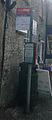 Burford Lower High Street bus stop pole.JPG