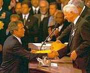 President pro tempore Byrd and House Speaker Dennis Hastert presided over a special joint session following the September 11, 2001 attacks. Here President Bush shakes hands with Byrd.