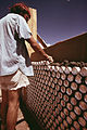 CONSTRUCTION OF ONE OF THREE EXPERIMENTAL HOUSES BUILT FROM EMPTY BEER AND SOFT DRINK CANS. ALL ALUMINUM CANS ARE... - NARA - 556638.jpg