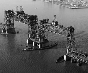 CRRNJ Newark Bay Bridge - The Central Railroad of New Jersey Newark Bay Bridge with its lifts raised (one of which had already been destroyed by collision); it was demolished in the 1980s