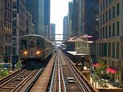 A Brown Line train departing from Madison/Wabash