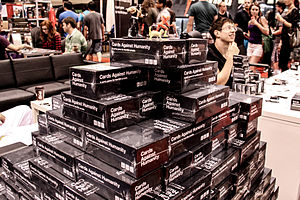 Cards Against Humanity - A stack of Cards Against Humanity boxes at Fan Expo Canada 2013.