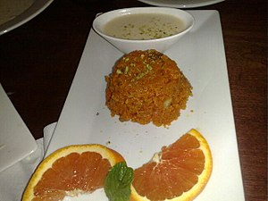 South Asian sweets - Carrot-based gajrela served with kheer and slices of orange.