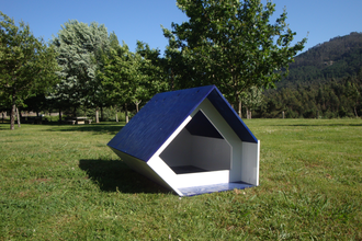 Doghouse - A wooden doghouse.