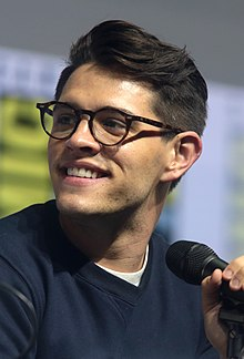 Photo of a bespectacled man with a microphone