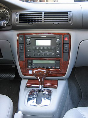 Center console (automobile) - The center console of a VW Passat featuring a floor mounted gear shift.