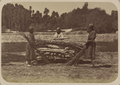 Central Asian Funerary Customs. Indian Funerals. Three Men Laying Wood on Top of a Body Lying on a Wooden Bier WDL10849.png