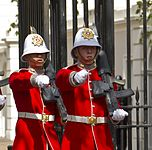 Two soldiers in red dress uniforms