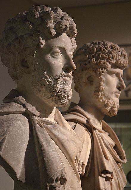 Busts of the co-emperors Marcus Aurelius (left) and Lucius Verus (right), British Museum Co-emperors Marcus Aurelius and Lucius Verus, British Museum (23455313842).jpg