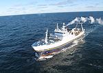 Coast Guard Kodiak-based HH-65 Dolphin helicopter crew medevacs fisherman from fishing vessel Golden Alaska DVIDS1137047.jpg