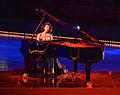 Concert pianist Khatia Buniatishvili on the podium of Art on Ice 2014-2.jpg