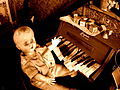 Creepy kid with a piano - sepia.jpg