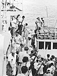 Crew of SS Mayaguez is transferred from a Thai fishing boat to USS Henry B. Wilson (DDG-7) on 15 May 1975.jpg