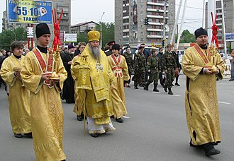 Subdeacon - Russian Orthodox subdeacons (red stoles) surrounding a bishop.
