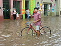 Cyclist on Flooded Street - Salta - Argentina.jpg