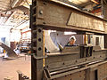 David Stromeyer at hydraulic press forming a section.jpg