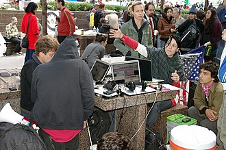 Media activism - Occupy Wall Street protesters in Zuccotti Park using their laptops, September 2011