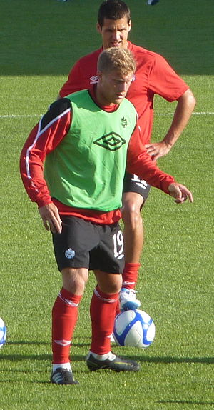 Marcel de Jong - De Jong warming up before a match against Ecuador at BMO Field on 1 June 2011 in front of Josh Simpson.