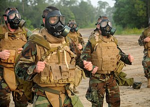 M40 field protective mask - US Navy Seabees jog during an exercise with M40s worn.
