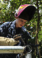 Defense.gov News Photo 100827-N-1531D-310 - U.S. Navy Petty Officer 3rd Class Yanina Schiller a hull maintenance technician assigned to the multipurpose amphibious assault ship USS Iwo Jima.jpg