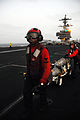 Defense.gov News Photo 110718-N-JE719-838 - Petty Officer 3rd Class Damion Ferguson left and Petty Officer 2nd Class Christopher Bowman transport ordnance on the flight deck of the aircraft.jpg