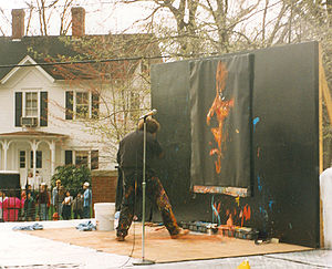 Denny Dent - Denny Dent painting Martin Luther King, Jr. at the Tufts University Spring Fling in 1995. The painting currently hangs in the Mayer Campus Center at Tufts.
