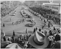 Distance view of procession of limousines as President Truman rides to the reviewing stand for the inaugural parade.... - NARA - 200038.tif