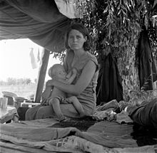 Dorothea Lange, Drought refugees from Oklahoma camping by the roadside, Blythe, California, 1936.jpg