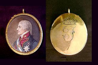 https://upload.wikimedia.org/wikipedia/commons/thumb/8/80/Dorso_medallon_ferVII.jpg/330px-Dorso_medallon_ferVII.jpg