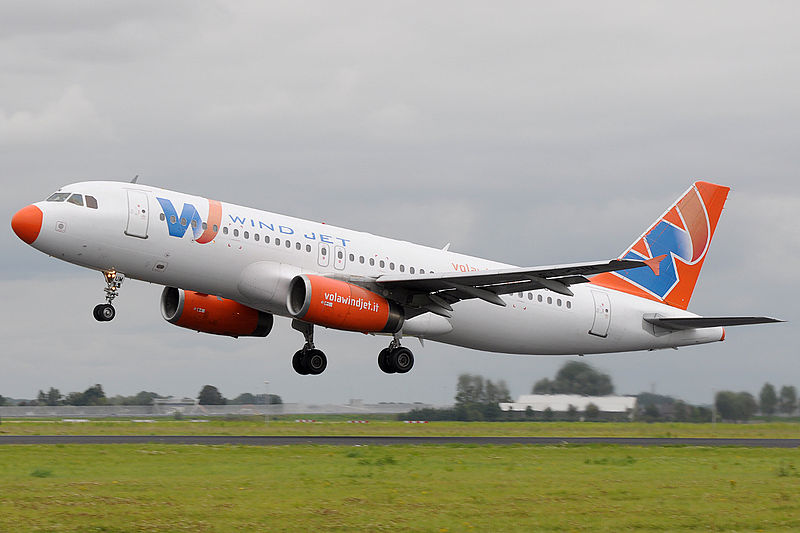 Wind Jet Airbus A320 landing at Schiphol Airport.