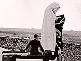 King Edward VIII unveiling a figure personifying Canada on the Vimy Memorial