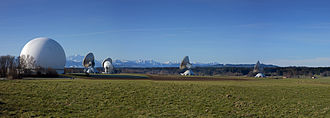 Antenna farm - A radome (left) among multiple Cassegrain satellite antennas located at the Raisting Satellite Earth Station complex.