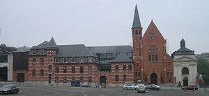 Convent Van Maerlant - The church on the left in red brick, the chapel is the small grey building to the right.