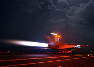 Fail-safe - An aircraft lights its afterburners to maintain full power during an arrested landing aboard an aircraft carrier. If the arrested landing fails, the plane can safely take off again.